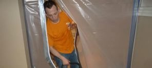 Water Damage Technician Using Air Mover Near Vapor Barrier To Clean Up Mold