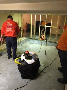 Water Damage Palm Coast Technicians Cleaning Carpet After A Flood